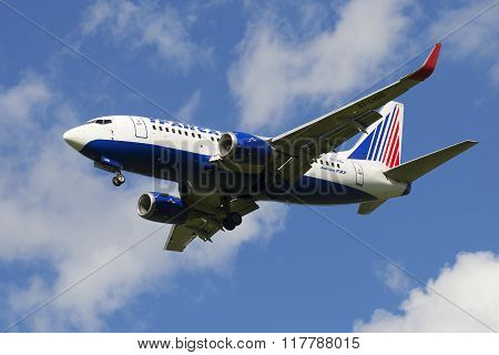 Flying aircraft Boeing 767 (EI-UNG) to Transaero on the background of cloudy sky