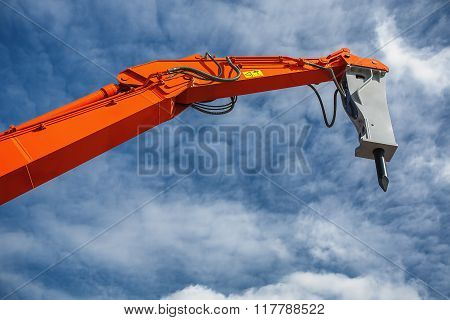 Backhoe Loader Or Bulldozer - Excavator Against Blue Sky