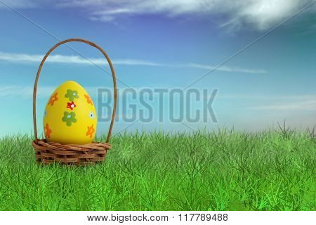 Painted Easter egg in a basket on grass with sky background