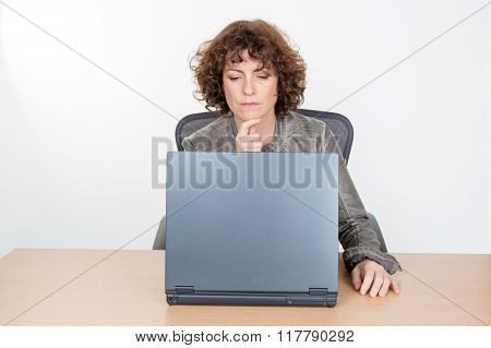 Serious Businesswoman Working On  Omputer At Desk