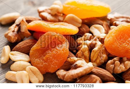 Dried Apricots With Nuts On Wooden Table Close-up