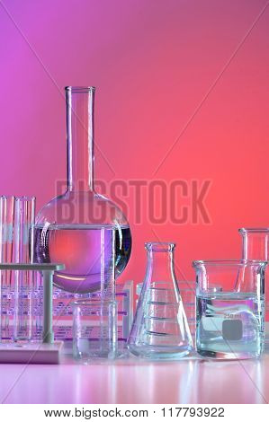 Laboratory glassware over colored background