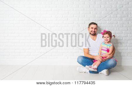 Family Father Child Daughter At A Blank White Brick Wall