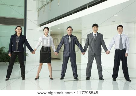 Business Team Holding Hands