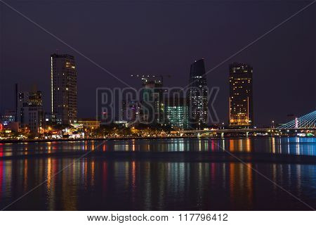 The embankment of the Han river at night illumination. Danang, Vietnam