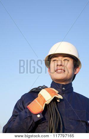 Manual worker looking away