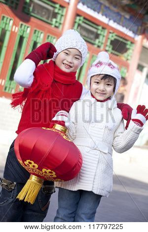 Children holding red lantern