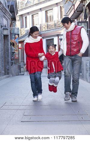 Family having fun in Hutong