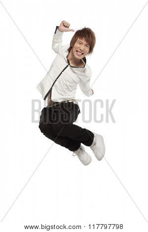 Portrait of an excited young man mid-air