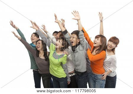 A group of young people looking up in excitement