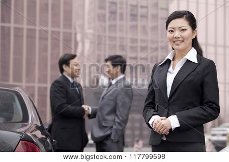 Three businesspeople outdoors