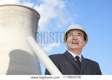 Businessman at power plant