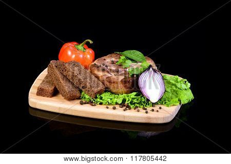 Meat steak with vegetables on a breadboard
