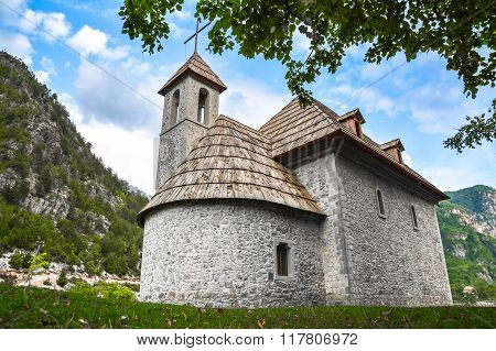 Stone Church With Wooden Roof In The Mountain Village