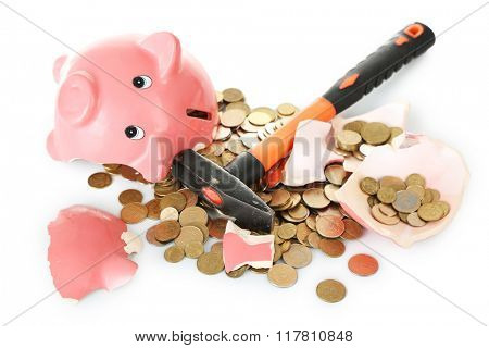 Piggy bank is broken by hammer isolated on white background