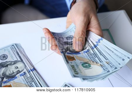 Hands counting money, close up