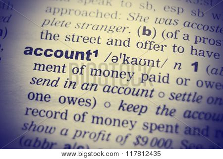 Close-up of word in English dictionary. Account, definition and transcription