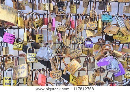 Paris, France, February 7 , 2016: Archbishop's Bridge in Paris, France, covered with love locks.