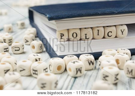 policy word written on wood block. Wooden ABC