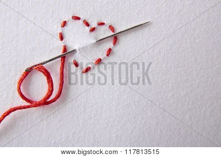 Embroidered Red Heart On A White Cloth Close Up
