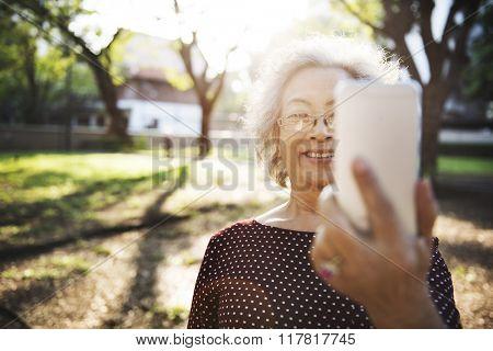 Mobility Senior Adult Online Selfie Concept