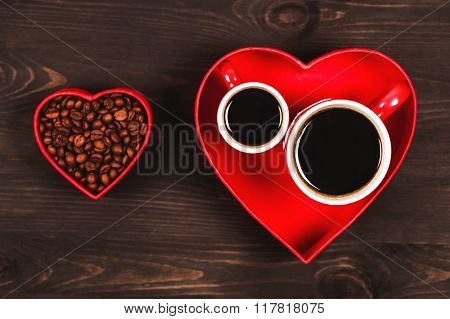 Two cups of coffee in the red heart