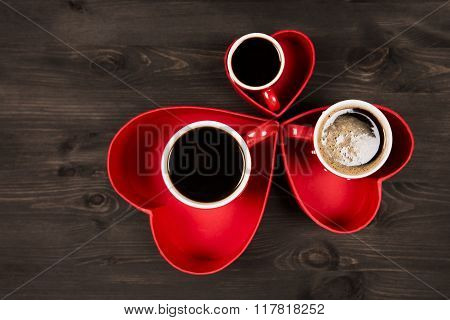 Three cups of coffee in the red heart