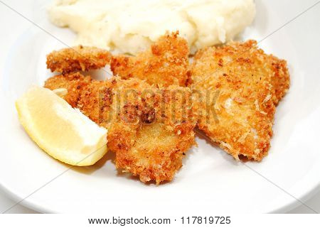 Fried Cat Fish Served With A Wedge Of Lemon