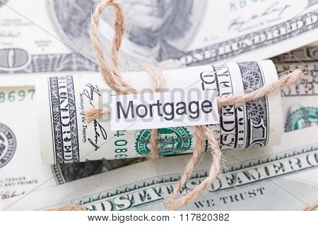 Money And Business Idea, The Dollar Bills Tied With A Rope, With A Sign - Mortgage