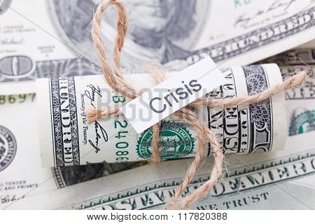 Money And Business Idea, The Dollar Bills Tied With A Rope, With A Sign - Crisis