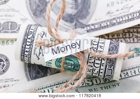 Money And Business Idea, The Dollar Bills Tied With A Rope, With A Sign - Money