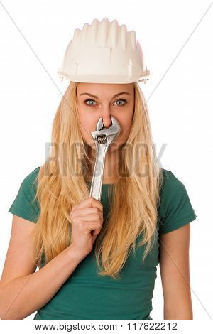 Woman With Constructor Helmet And Tools Gesturing .stuffy Nose