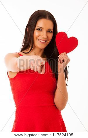 Woman In Love Wearing Red Dress Holding Red Heart Sending Message To Her Boyfriend.
