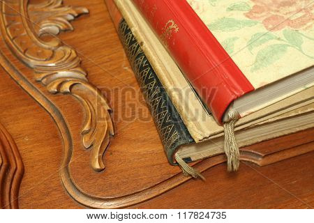 two closed old books on wooden background