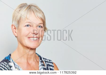 Smiling happy senior woman with grey hair