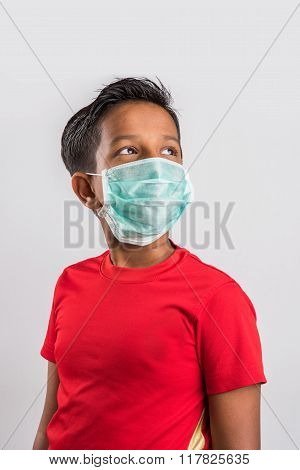 indian boy wearing face mask, Flu illness child boy in medicine healthcare mask, A Little indian boy