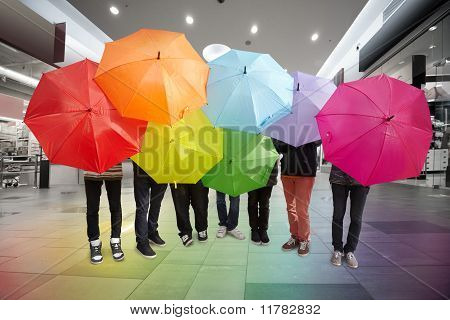 Seven Friends With Rainbow Umbrellas In Wide Hall Trading Centre Collage