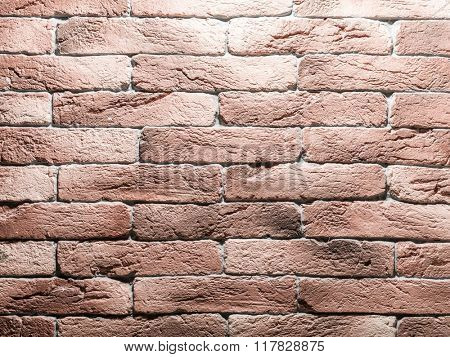 Red brick wall. Close-up picture of bricks.