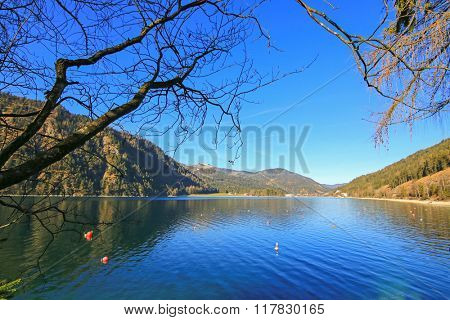 Good weather day with blue sky at the Achensee Lake during winter in Tirol, Austria. The Achensee is the largest lake within the federal state, and has a maximal depth of 133 meters