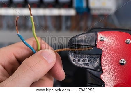 Electrician Hands Stripping Electrical Wires