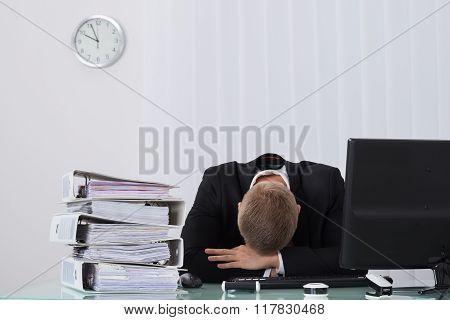 Male Businessman Sleeping In Office