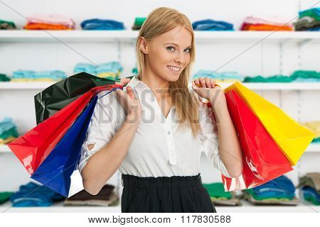 Beautilful Young Woman Carrying Shopping Bags