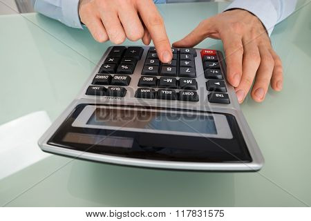 Businessperson Using Calculator