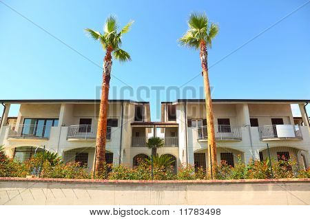 Two Luxury Cottages With Balcony And Garden With Palm Trees Are Fenced
