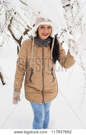 Smiling Woman In Snow Outside