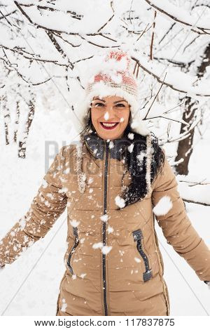Cheerful Woman Tossing Snow Flakes