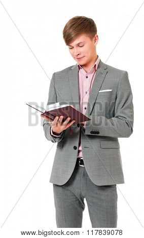 Young businessman in suit with notepad, isolated on white background
