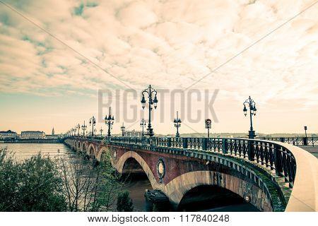Bordeaux river bridge with St Michel cathedral, France