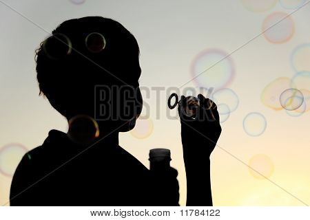 Little Boy Inflating Many Soap Bubbles Silhouette, Sky