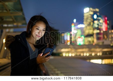 Woman look at phone at night